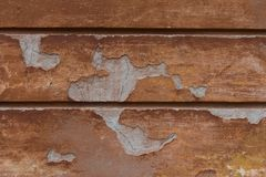 Aged orange ruined wall. Cracked plaster. Detailed vintage background. Royalty Free Stock Images