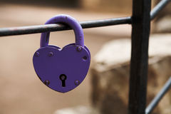 Aged padlock. Love heart shape design, violet paint metal texture, pattern and vintage design. love sign and romance Stock Photos