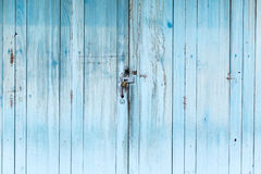 Aged paint old vintage wooden house door. Royalty Free Stock Image