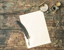 Aged paper and antique writing accessories. Vintage style Royalty Free Stock Image