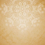 Aged paper background with ornament. Aged paper background with round seamless ornament Royalty Free Stock Image