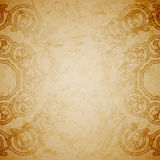 Aged paper background with round ornament Royalty Free Stock Photo