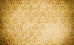 Aged paper background with vintage patterns. Royalty Free Stock Images