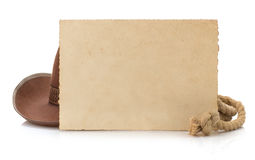 Aged paper and cowboy hat. On white background royalty free stock photography