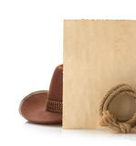 Aged paper and cowboy hat Stock Photography