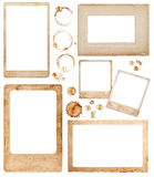Aged paper photo frames and coffee stains. scrapbook elements. Old aged paper photo frames and coffee stains isolated on white background. scrapbook elements stock photos