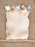 Aged paper with sea shells and rope on sacking background Royalty Free Stock Photos