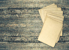 Aged paper sheets over rustic wooden background. vintage texture Royalty Free Stock Image
