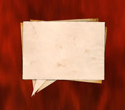 Aged paper speech bubble on the wood Royalty Free Stock Images
