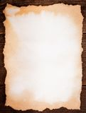 Aged paper on wood Royalty Free Stock Photography