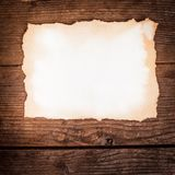 Aged paper on wood Stock Photography