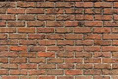 Brick Wall for Background Use. An aged and patched, multi-textured brick wall for backgrounds or presentations Stock Photos