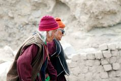 Aged people gathering for Dalai Lama speech. CHOKLAMSAR, LADAKH-AUGUST 21: Old aged people moving to Shewatsel ground at Choklamsar near Leh, Ladakh, India to Stock Image