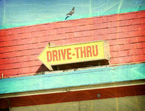 Aged photo of drive thru sign Stock Photos