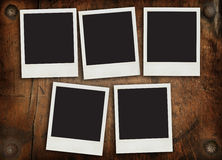 Aged photo frames on timber wall Royalty Free Stock Photos