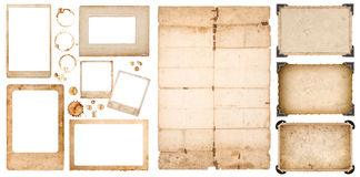Aged photo frames used paper sheet coffee stains scrapbook. Aged photo frames, used folded paper sheet and coffee stains on white background. Scrapbook elements Stock Photos