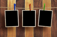 Aged photo frames on wood background Stock Photography
