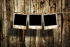 Aged photo frames on wood background Royalty Free Stock Photography