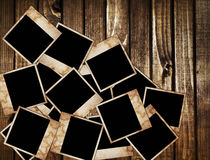 Aged photo frames on wood background Royalty Free Stock Photo