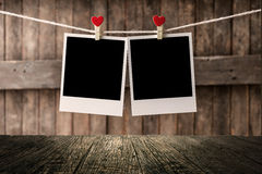 Aged photo frames on wood background Stock Photos