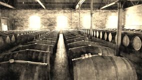 Aged photo of vintage wine barrels in Rows Royalty Free Stock Images