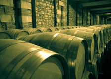 Aged photo of winery with  many wooden barrels Stock Photo
