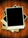 Aged photographs on wood background Royalty Free Stock Image
