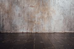 Aged planks floor and concrete wall background Stock Photos