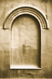 Aged plastered faux arch false fake window frame Royalty Free Stock Images