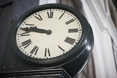 Aged railway station clock with Roman numerals Royalty Free Stock Images