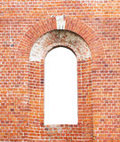 Aged red brick arch with copy space inside Royalty Free Stock Images