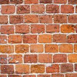 Aged red brick wall pattern. Vintage brickwork abstract object, white seam. Stock Photo