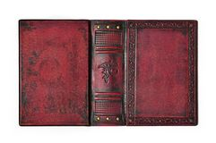 Aged Red Leather Book Cover With The Embossed Ancient Egyptian Symbol `The Eye Of Horus` Lay Down To The Table Opened Royalty Free Stock Photography