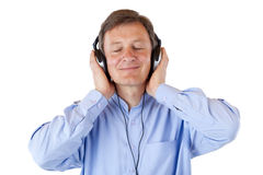 Aged relaxed senior man listen to mp3 music Stock Photos