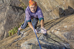 Aged rock climber Stock Images
