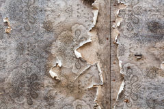Aged room wall background with torn vintage wallpaper. Royalty Free Stock Photo
