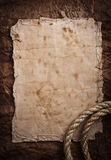 Aged Rope on the old paper background Royalty Free Stock Photo