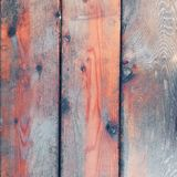 Aged rustic wooden board background texture in red and blue. Image of aged rustic wooden board background texture, blue red colors Stock Photography