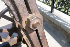 Aged rusty nut on the old mechanism. Stock Photo