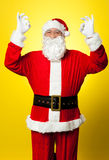Aged Santa gesturing perfect sign with both hands Stock Photos