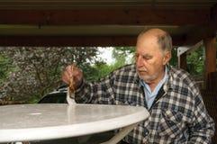 Aged senior man painting Stock Photo