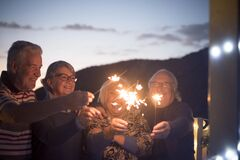 Free Aged Senior People Friends Have Fun And Celebrate By Night With Fire Sparkler - Concept Of New Year Eve And Mature Retired Couples Royalty Free Stock Photos - 191297368