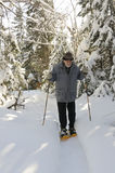Aged senior with snowshoes royalty free stock image
