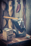 Aged shoemaker workshop with shoes, laces and tools Royalty Free Stock Photography