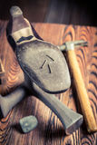 Aged shoemaker workshop with tools, shoes and laces Royalty Free Stock Photo
