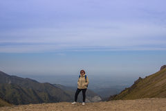 Aged sport woman in sunglasses are standing at Talgar pass, Tien Royalty Free Stock Photo