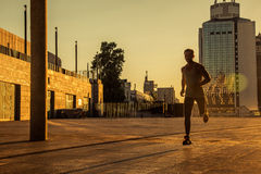 Aged sportsman running on country road, healthy inspirational fitness lifestyle, sport motivation speed interval training. Runner jogging training and doing Royalty Free Stock Image