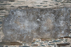Aged Stone Wall with Patch Royalty Free Stock Photography