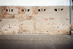 Aged street wall Stock Images