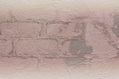 Aged stucco on bricks. Texture of aged stucco on bricks in high resolution Royalty Free Stock Image